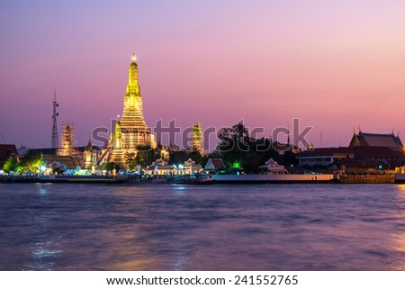 wat arun also call temple of dawn is in the bank of chaophraya river in bangkok , thailand - stock photo
