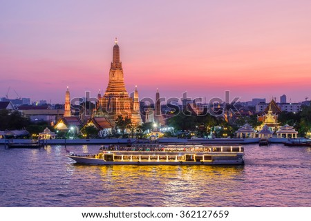 Wat Arun and cruise ship in night ,Bangkok city ,Thailand - stock photo