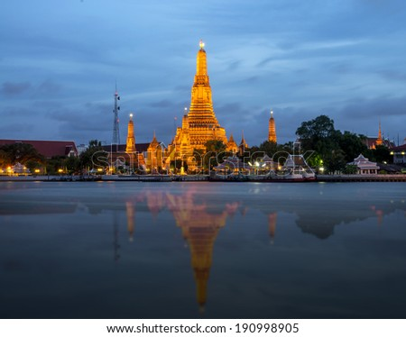 Wat Arun river side with Chao Phraya River in Bangkok at twilight time, Thailand - stock photo