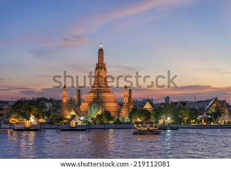 Wat Arun Temple across Chao Phraya River at Twilight Bangkok, Thailand - stock photo