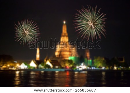 Wat Arun Temple with firework in bangkok thailand ,abstract blurred background - stock photo