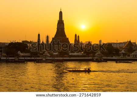 Wat Arun, the evening sunset. - stock photo