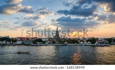 Wat Arun, The Temple of Dawn, at sunset,view across river. Bangkok, Thailand