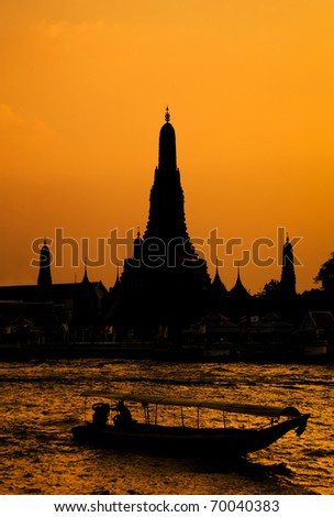 Wat Arun, The Temple of Dawn, at sunset,view across river. Bangkok, Thailand - stock photo