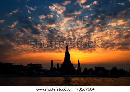 Wat Arun, The Temple of Dawn, at sunset,view across river. Bangkok, Thailand - stock photo