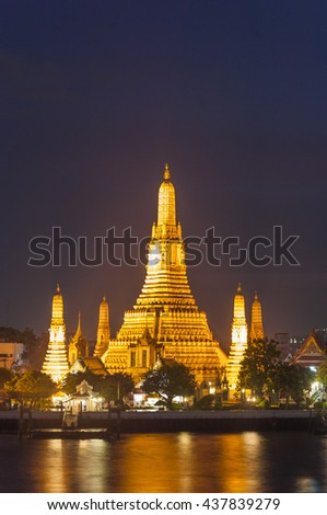 Wat Arun, The Temple of Dawn, at sunset,view across river. Bangkok, Thailand. Wat Arun Rajwararam or the Temple of Dawn, is named after Aruna, the Indian God of Dawn. - stock photo