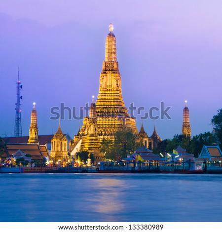Wat Arun, The Temple of Dawn, at twilight, view across  Chao Phraya river. Bangkok, Thailand. - stock photo