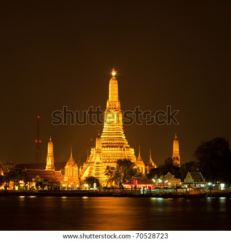 Wat Arun, The Temple of Dawn, at twilight, view across river. Bangkok, Thailand - stock photo