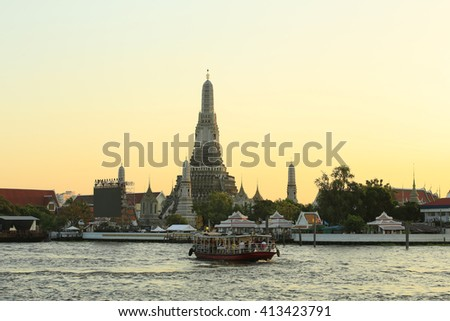 Wat Arun, the Temple of Dawn, stands on the Chao Phraya river in Bangkok, Thailand. - stock photo