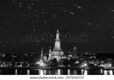 Wat Arun twilight reflection water and stars in Bangkok Thailand. - stock photo
