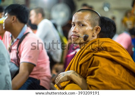 WAT BANG PHRA, THAILAND - MART 19, 2016: Unidentified monk master Yantra Tattoos at Bang Phra buddhist monastery, about 50 km west of Bangkok during Master Day Ceremony. - stock photo