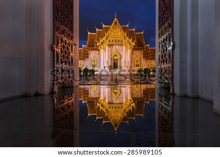 Wat Benchamabophit in Bangkok at twilight time with reflection o - stock photo
