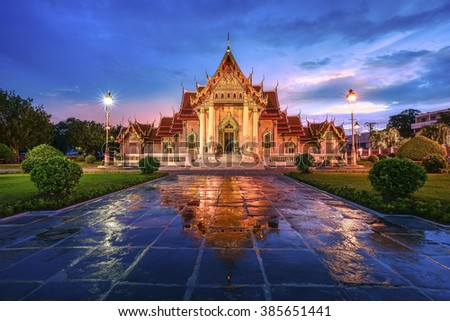 Wat Benchamabophit, the marble temple in Bangkok Thailand , after rainy and twilight time, this temple was built in Buddhist era 2441, this year is Buddhist era 2559. - stock photo