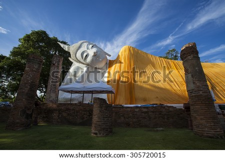 Wat Khun Inthapramun is ancient temple in Angthong, Thailand that was constructed during Sukhothai period. The highlight is largest and longest reclining Buddha statue in Thailand. - stock photo