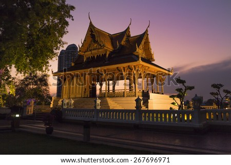 Wat, pagoda at sunset in Santichai Prakan Public Park (Suan Santichai Prakan), Bangkok - stock photo