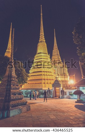 Wat Pho, Buddhist temple at night , Bangkok, Thailand.(Vintage filter effect used)