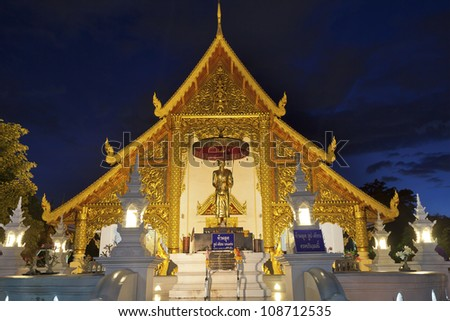 Wat Phra Singh temple at night in Chiang Mai, Thailand. - stock photo