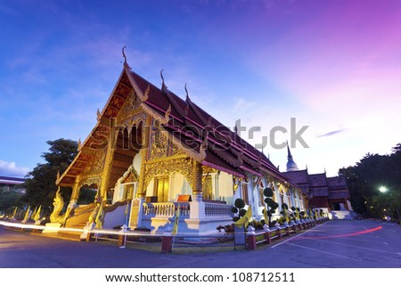 Wat Phra Singh temple at sunset in Chiang Mai, Thailand.