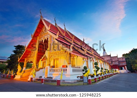 Wat Phra Singh temple at sunset in Chiang Mai, Thailand. - stock photo