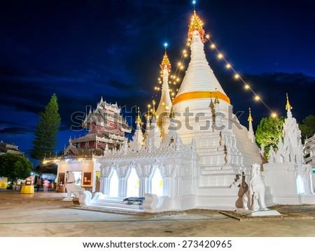 Wat phra that Doi kong mu temple , Beautiful white pagoda at twilight time , maehongson , Thailand - stock photo