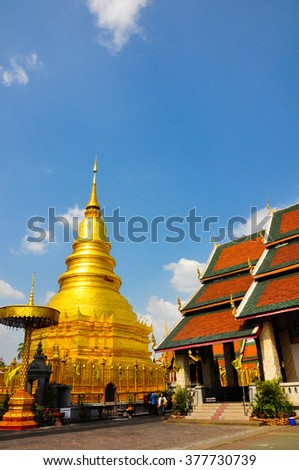 Wat Phrathat Hariphunchai Woramaha vihan, Lamphun, Thailand  -- Beautiful Northern Lanna Thai Temple Architecture of Golden Pagoda and Chapel Roof