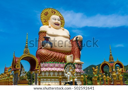 Wat Plai Laem temple with giant fat laughing Buddha statue and smaller golden temples around, Koh Samui, Thailand
