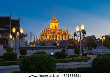 Wat Ratchanatdaram(Loha Prasat) temple during twilight time, Bangkok, Thailand - stock photo