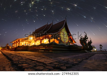 Wat Sirindhorn,stars lights night sky Phuproud temple in Northeast  thailand . - stock photo