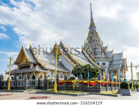 Wat Sothon temple famous chapel gray gold color shining in chachoengsao, thailand - stock photo