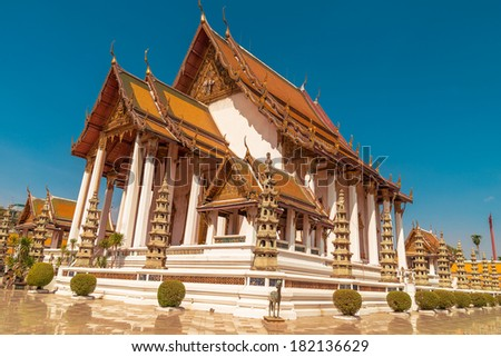 Wat Suthat, royal temple at the Giant Swing in Bangkok in Thailand. Built in 1782-1809.Ancient construction of public property. - stock photo