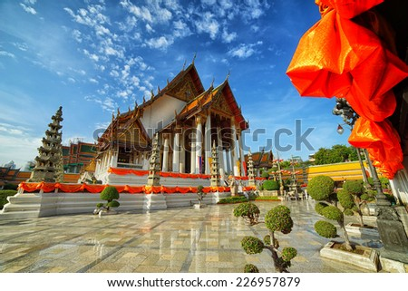Wat Suthat Thepphawararam with blue sky background - stock photo