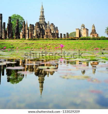 Wat Traphang Thong with reflection in the pond. Sukhothai - stock photo