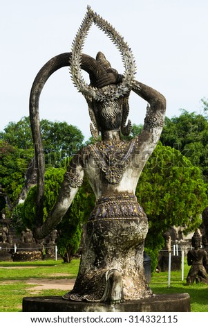 Wat Xieng Khuan Buddha park. Famous landmark of Buddhist stone statues and religious figures.Vientiane, Laos.They are public domain or treasure of Buddhism, no restrict in copy or use. - stock photo
