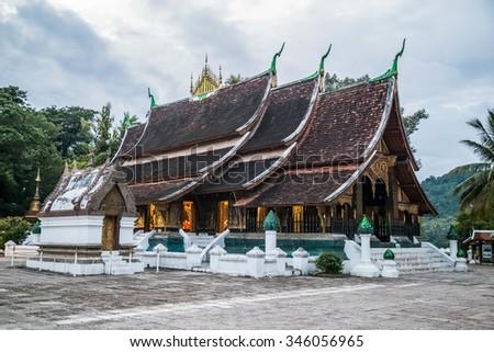 Wat Xieng Thong Buddhist temple in Luang Prabang, Laos - stock photo