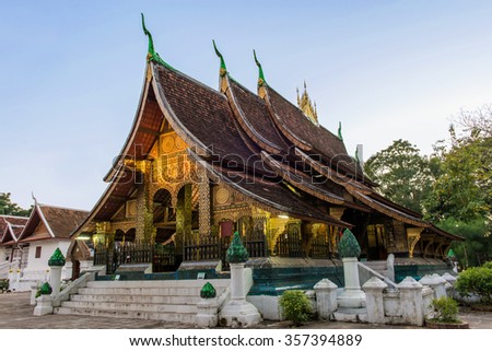 Wat Xieng thong temple at twilight time in Luang Pra bang, Laos. - stock photo