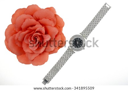 Watch and flower brooch - stock photo