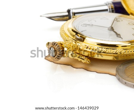 watch and ink pen at vintage parchment isolated on white background