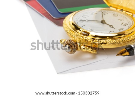 watch and pen at envelope isolated on white background