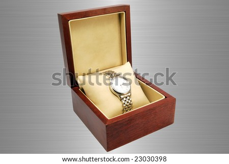 watch and wooden box on steel background