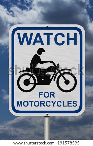 Watch For Motorcycles Warning Sign, An road warning sign with words Watch For Motorcycles and a motorcycle icon with blue sky background - stock photo