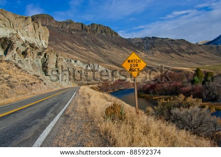 Watch for Rock Sign:  A road sign warns of possible fallen rock on a scenic highway in eastern Idaho. - stock photo