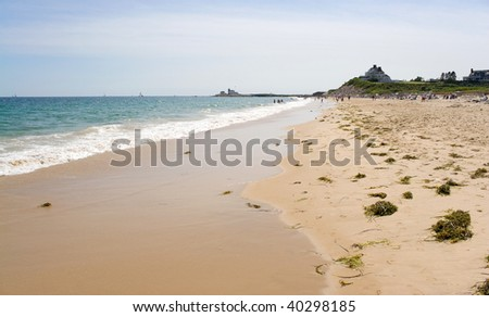 Watch Hill Rhode Island beach with the historic lighthouse landmark in the distance. - stock photo