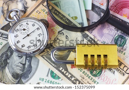 watch, magnifying glass, lock and money - stock photo