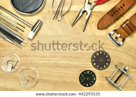 Watch maker and watc fix Tools on wood table , Upper view - stock photo