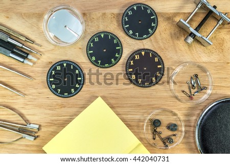 Watch maker tools and watch fix on wood table , upper view - stock photo