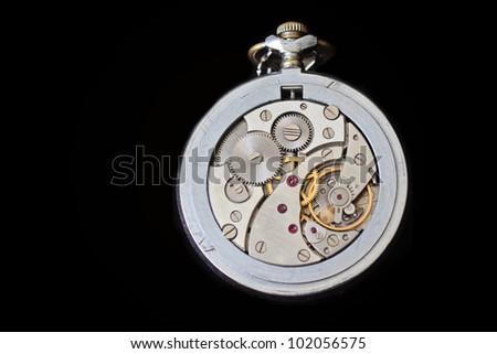 Watch mechanism, mechanical pocket watch - stock photo
