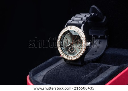 watch on a black background - stock photo