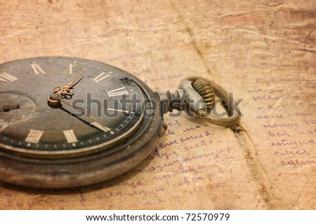 watch on an old notebook with the text - stock photo