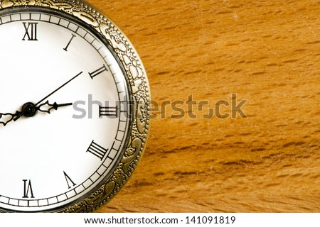 watch on wooden table - big close-up - stock photo
