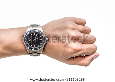 Watch on wrist isolated over a white background - stock photo